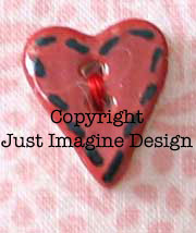 heart button with black stitching